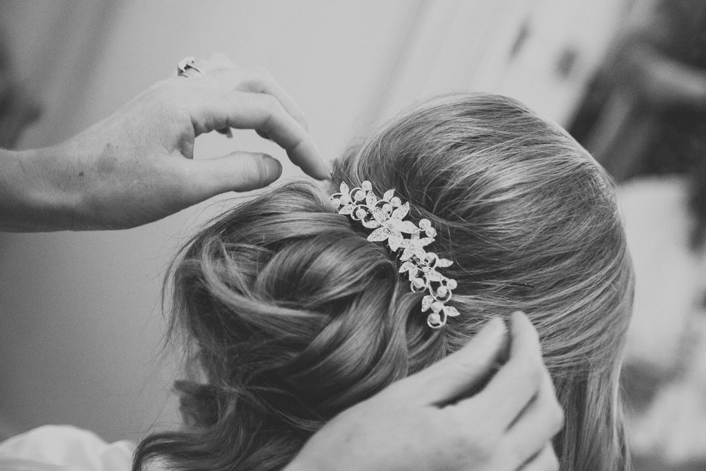 Bride having her hair done at Eshott Hall in Northumberland