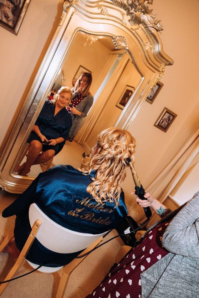 Brides mum having her hair styled
