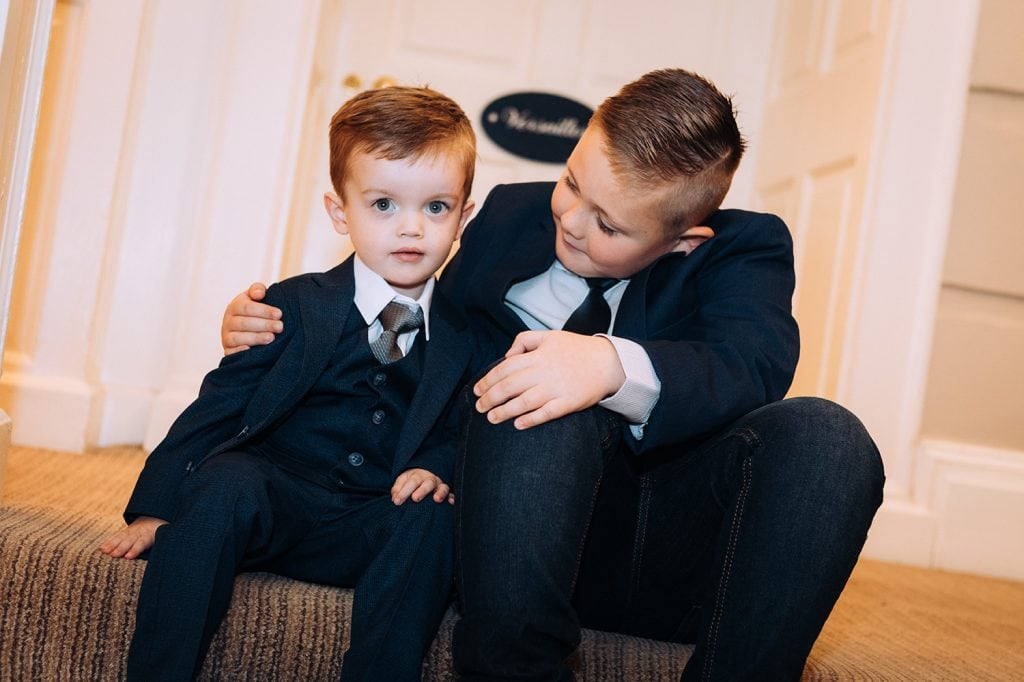 Pageboy getting a hug from his relative