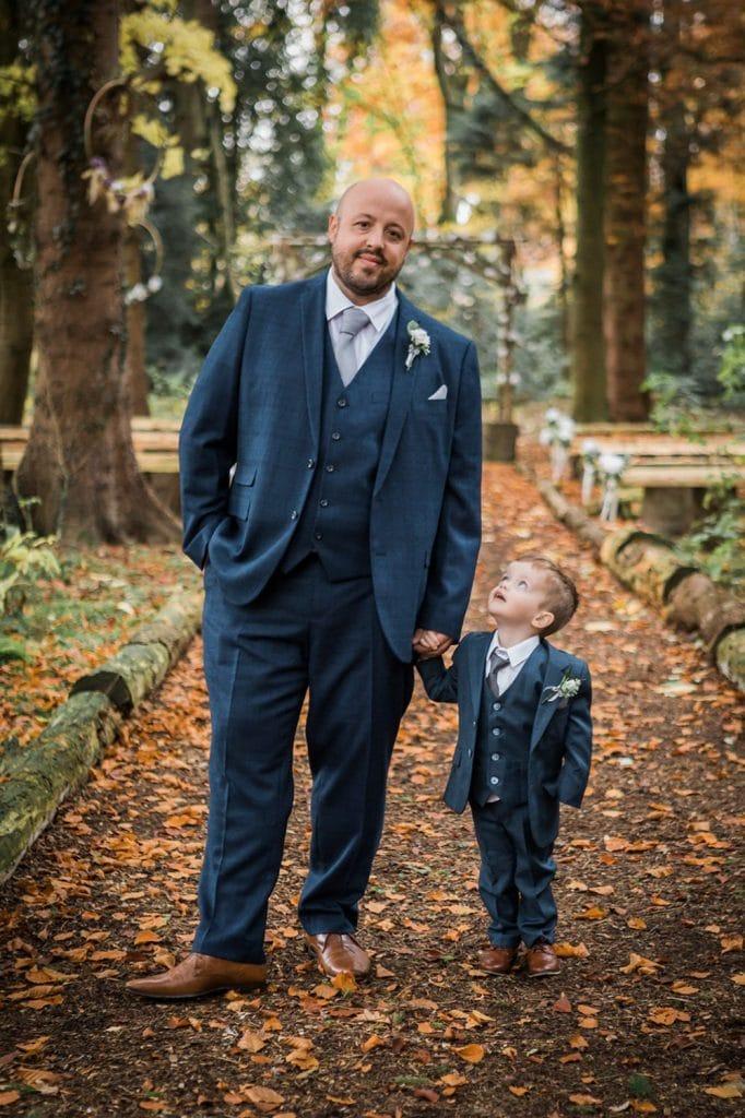 Page Boy looking up at his dad at Eshott Hall in Northumberland