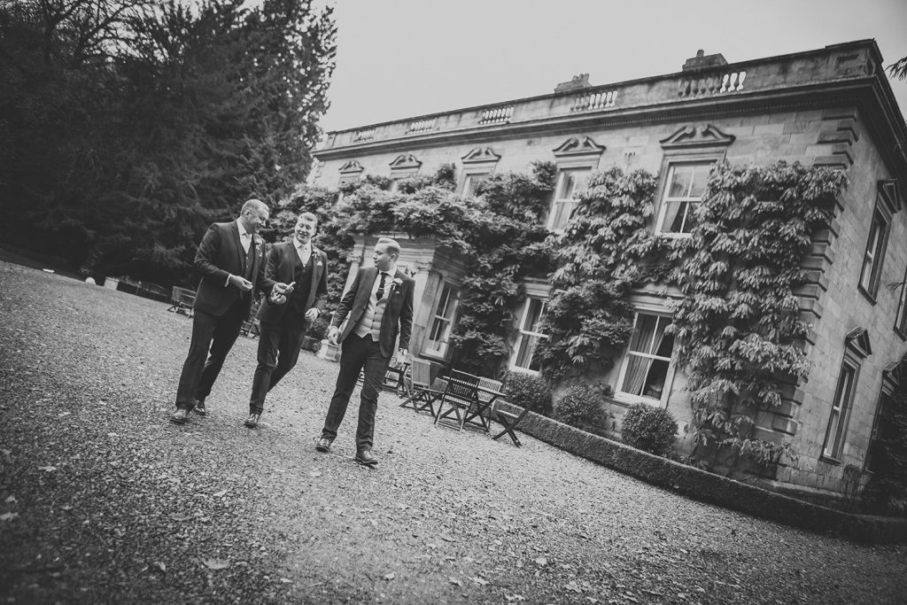 Groom, his brother and dad walking from Eshott Hall to the Reading Room