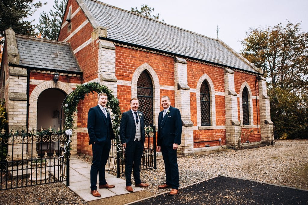 Groom, his brother and dad outside of the Reading Room in Eshott