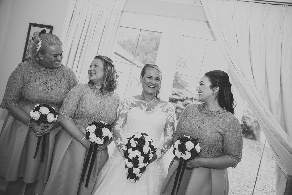Bride & Bridesmaids Laughing at Eshott Hall, Northumberland