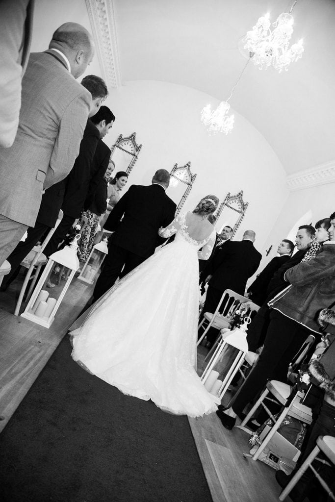 Bride walking up the aisle at the Reading Room in Eshott