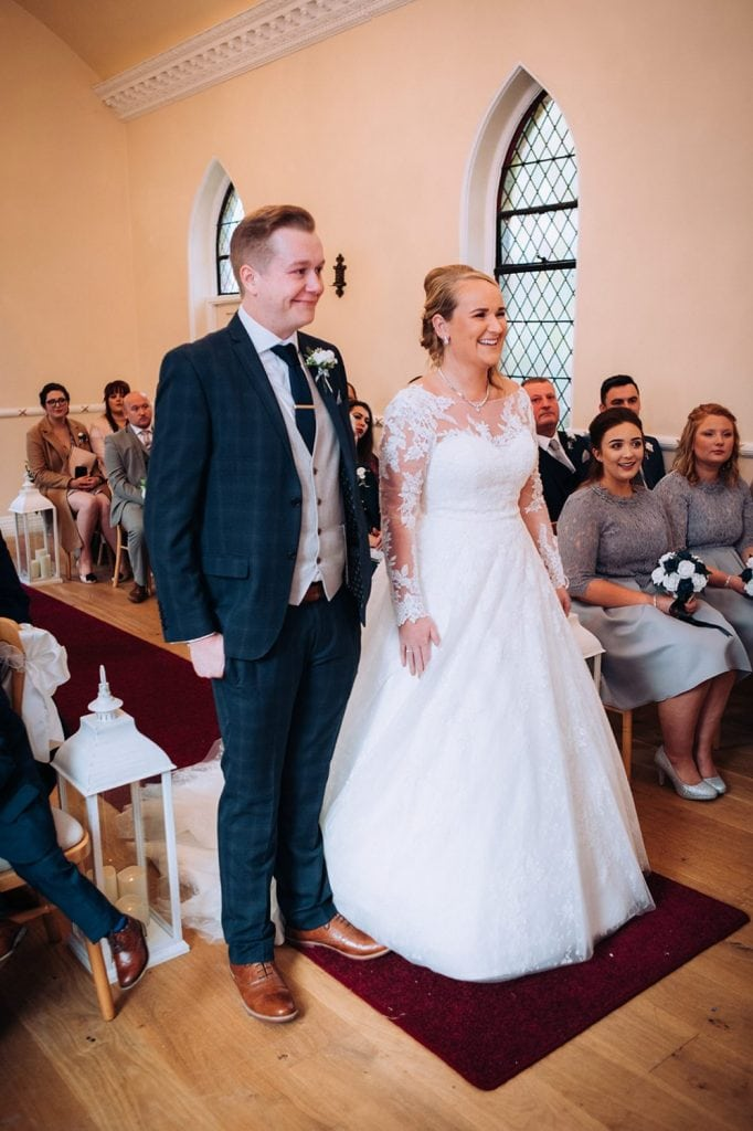 bride & groom laughing during the wedding service in the Reading Room in Eshott