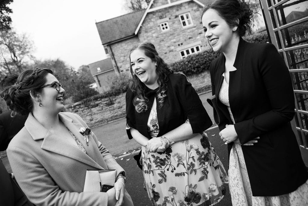 Guests laughing outside the Reading Room in Eshott