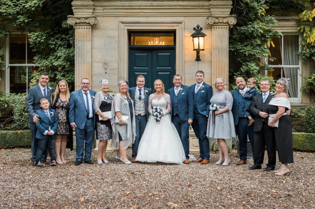 Family group in front of Eshott Hall, Northumberland