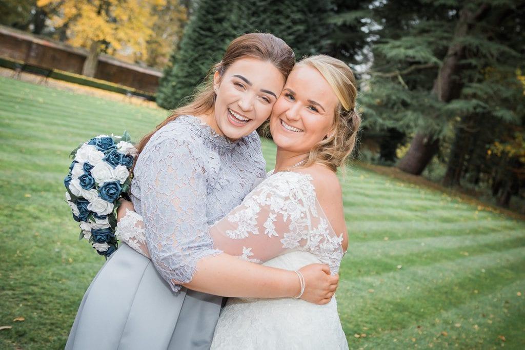 Maid of Honor & Bride hugging