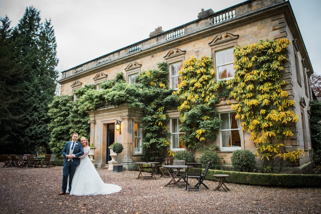 Bride & Groom posing in front of Eshott Hall, Northumberland