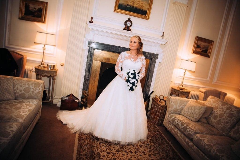 The Bride enjoying the fire in Eshott Hall, Northumberland