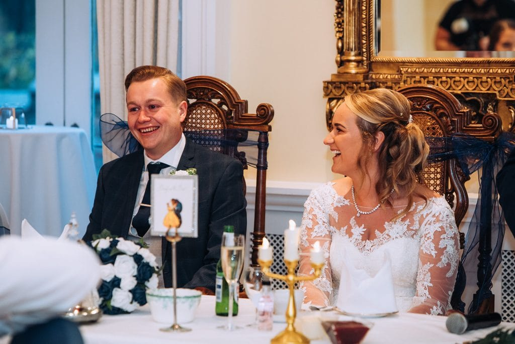 Bride & Groom laughing at maid of honors speech