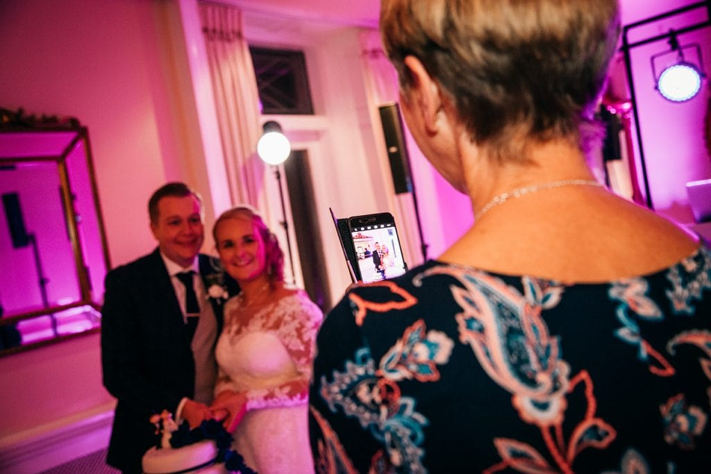 Bride & Groom having their photo taken by a guest at Eshott Hall, Northumberland