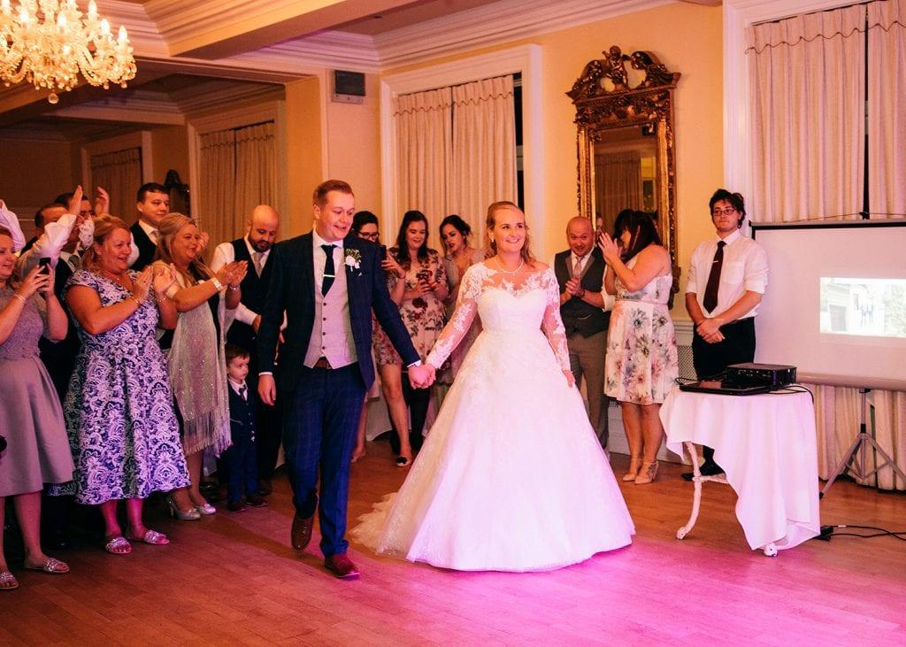 Bride & Groom walking onto the dance floor