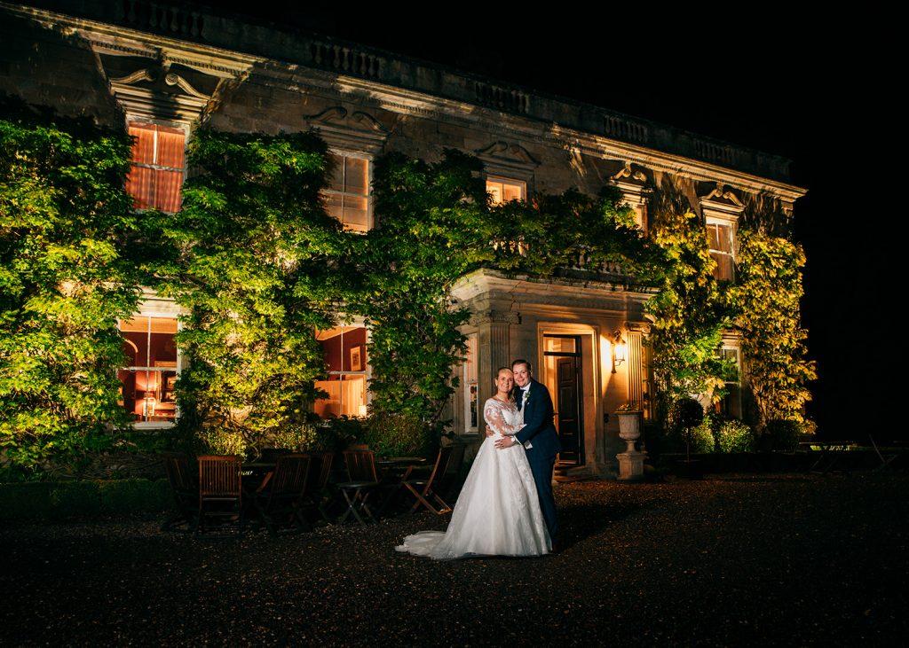 Bride & Groom at night infront of Eshott Hall, Northumberland