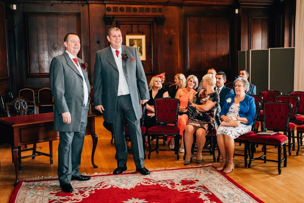 Bestman & Groom watching the bridesmaid walk down the aisle