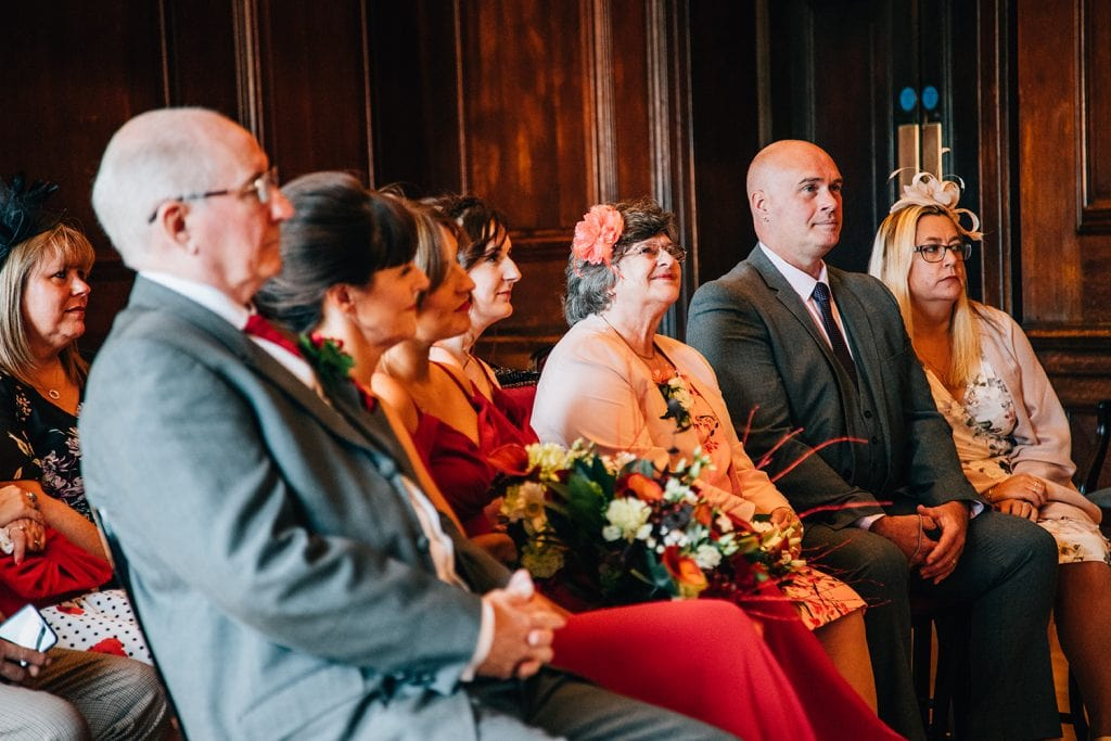 Family watching the wedding service in Morpeth Town Hall