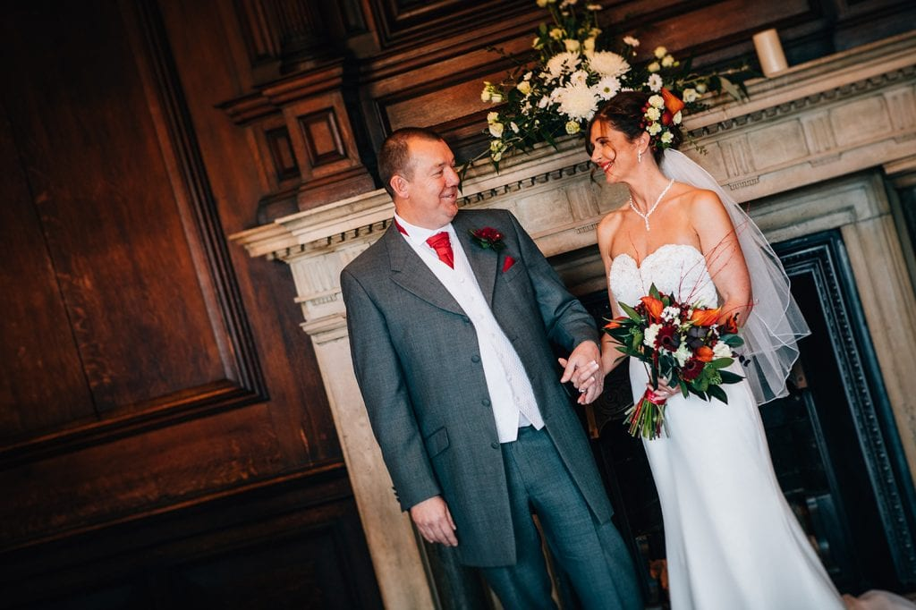 Bride & Groom holding hands in the Ballroom, Morpeth Town Hall