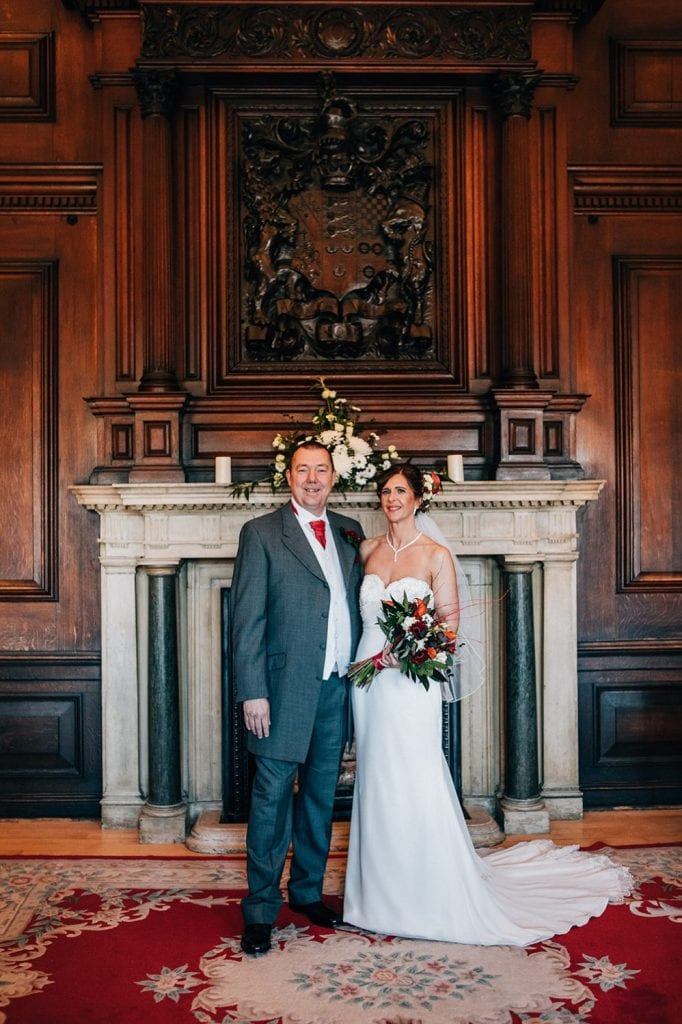 Bride & Groom standing in front of the fireplace Ballroom, Morpeth Town Hall