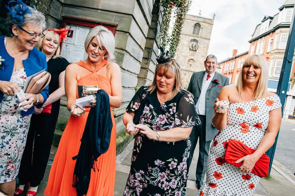 Family getting confettii ready outside of Morpeth Town Hall