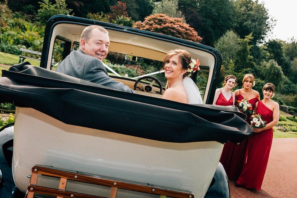 Bride & Groom sitting in their wedding car at Carlisle Park, Morpeth