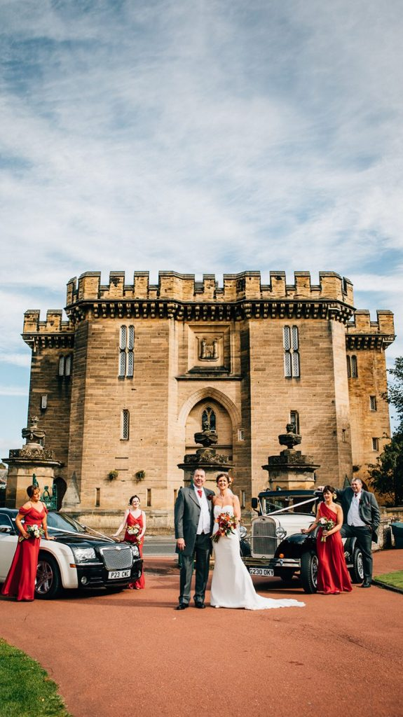 Bridal Party next to their wedding cars at Carlisle Park, Morpeth before the Waterford Lodge Hotel