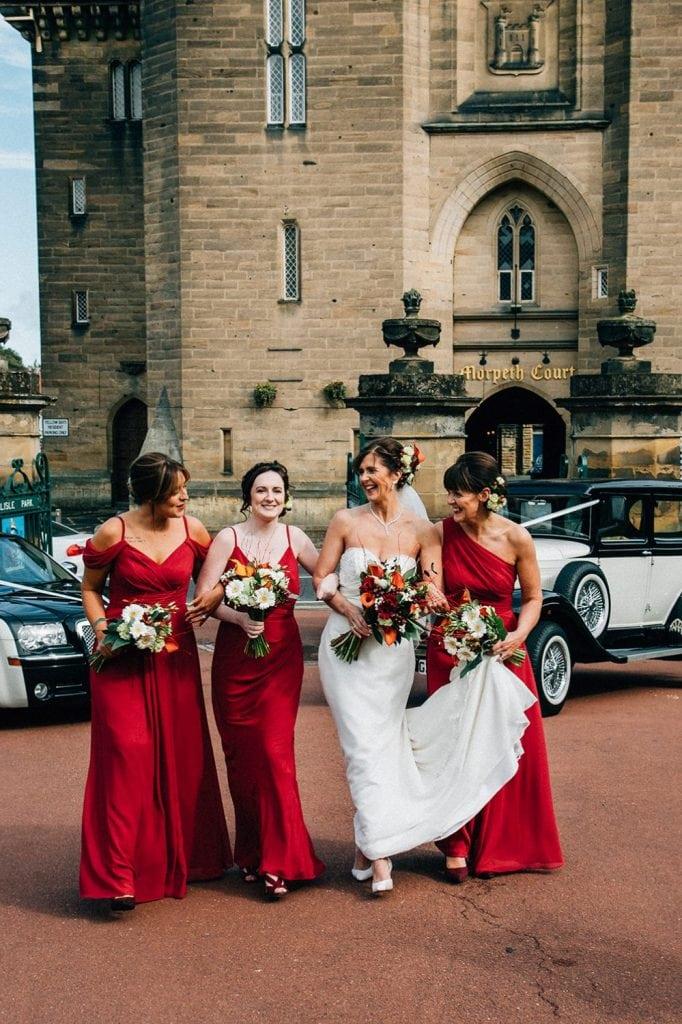 Bride walking into Carlisle Park, Morpeth