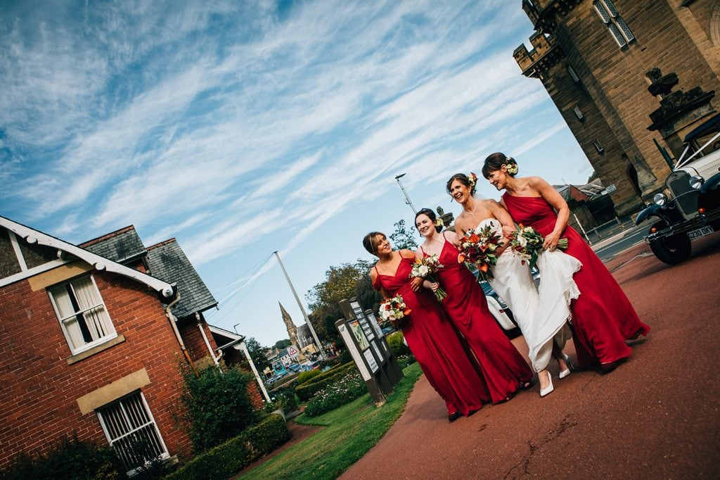 Bride with bridesmaids at Carlisle Park, Morpeth before the Waterford Lodge Hotel