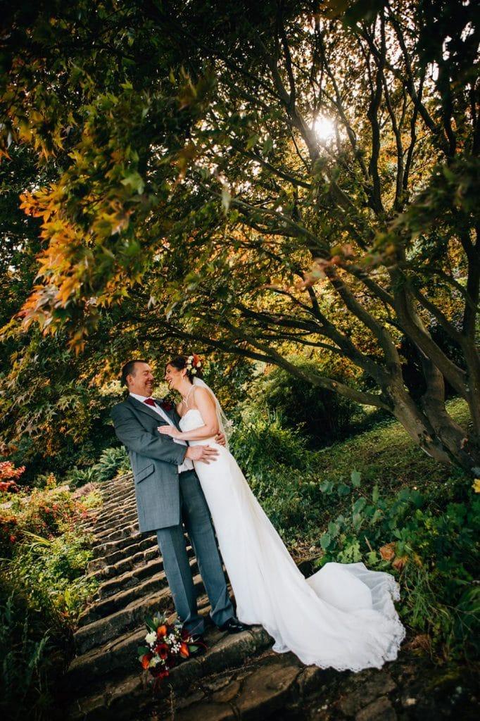 Bride & Groom on the steps at Carlisle Park, Morpeth