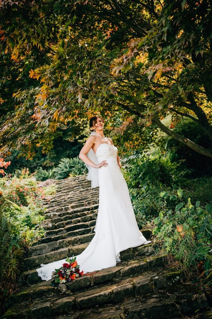 Bride posing on the steps at Carlisle Park, Morpeth next to the Waterford Lodge Hotel