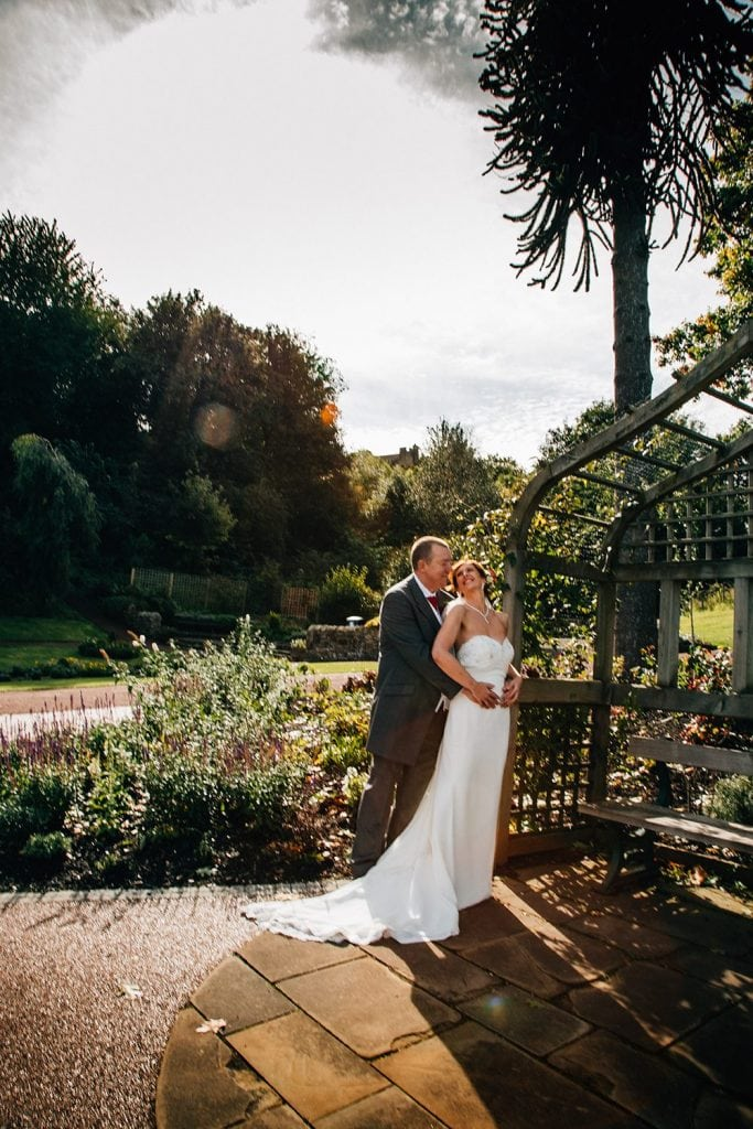 The bride & groom enjoying the sunshine at Carlisle Park, Morpeth next to the Waterford Lodge Hotel