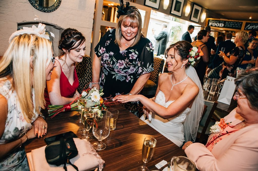 Bride showing friends her wedding ring at The Waterford Lodge Hotel in Morpeth