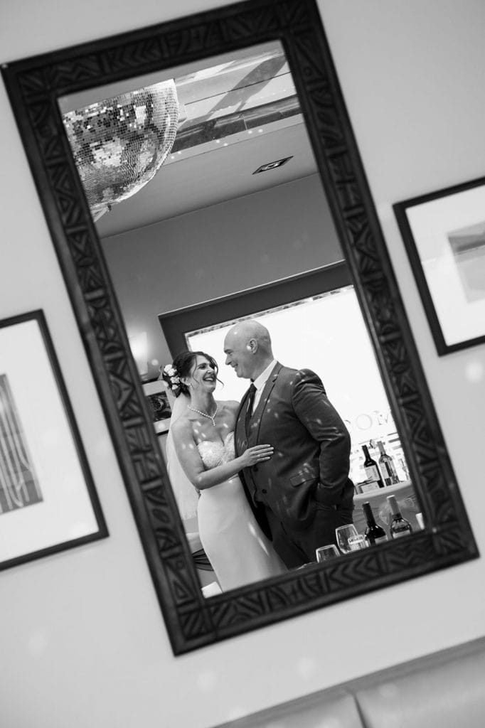 Reflection of the bride with her brother at The Waterford Lodge in Morpeth