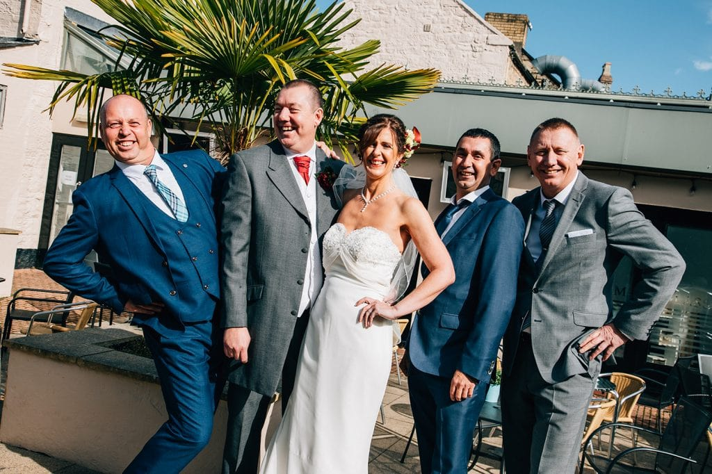 Lad posing with the bride at The Waterford Lodge in Morpeth
