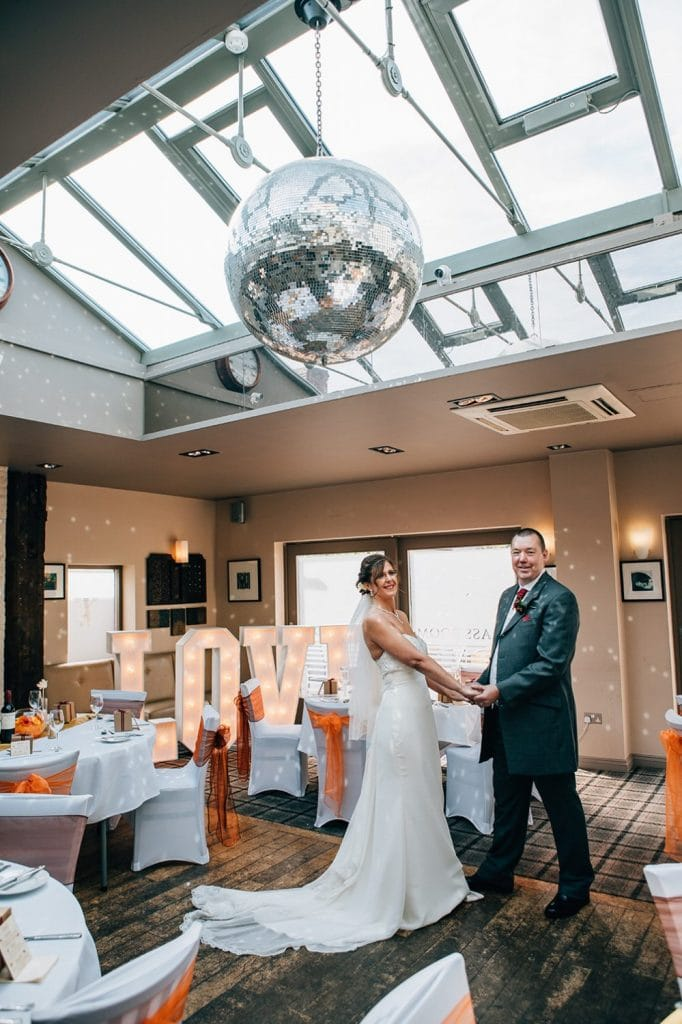 Bride & Groom under the glitterball at The Waterford Lodge Hotel in Morpeth