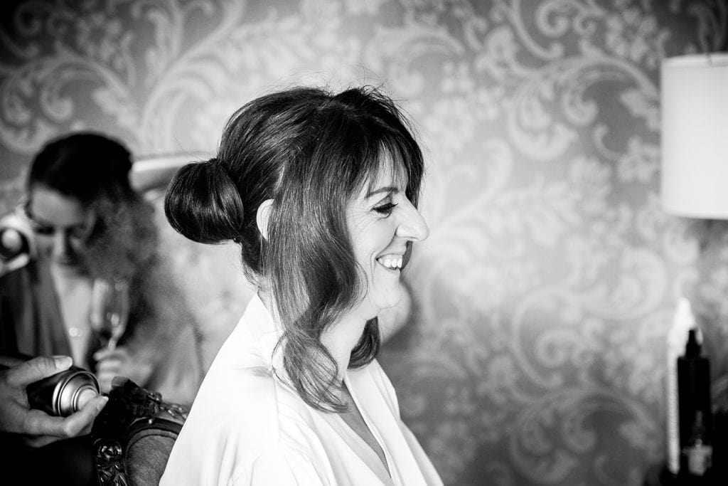 Bride getting hair styled at Ellingham Hall in Northumberland