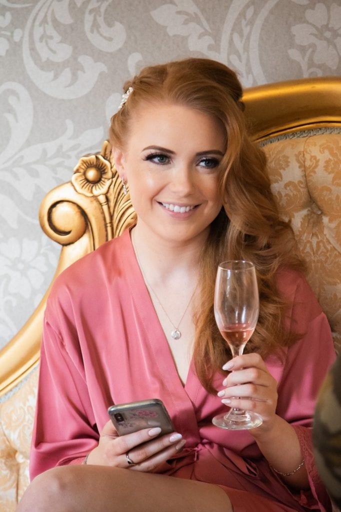 bridesaid enjoying champayne at Ellingham Hall in Northumberland
