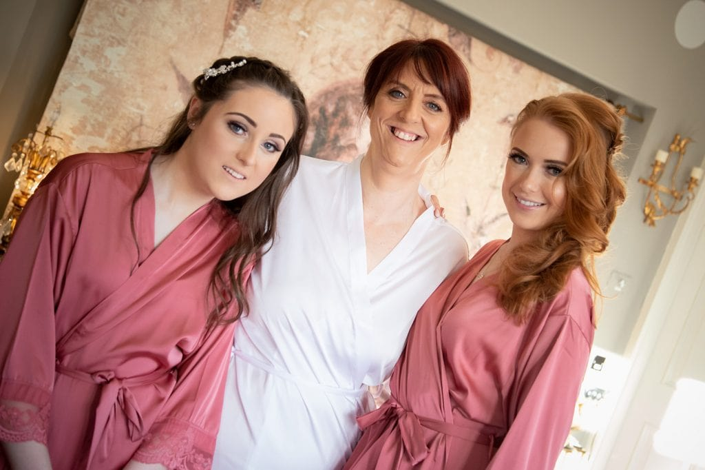 Bride with her bridemaids Ellingham Hall in Northumberland