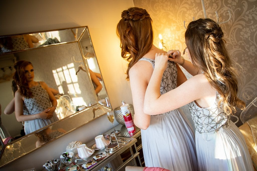 Bridesmaids getting ready at Ellingham Hall in Northumberland