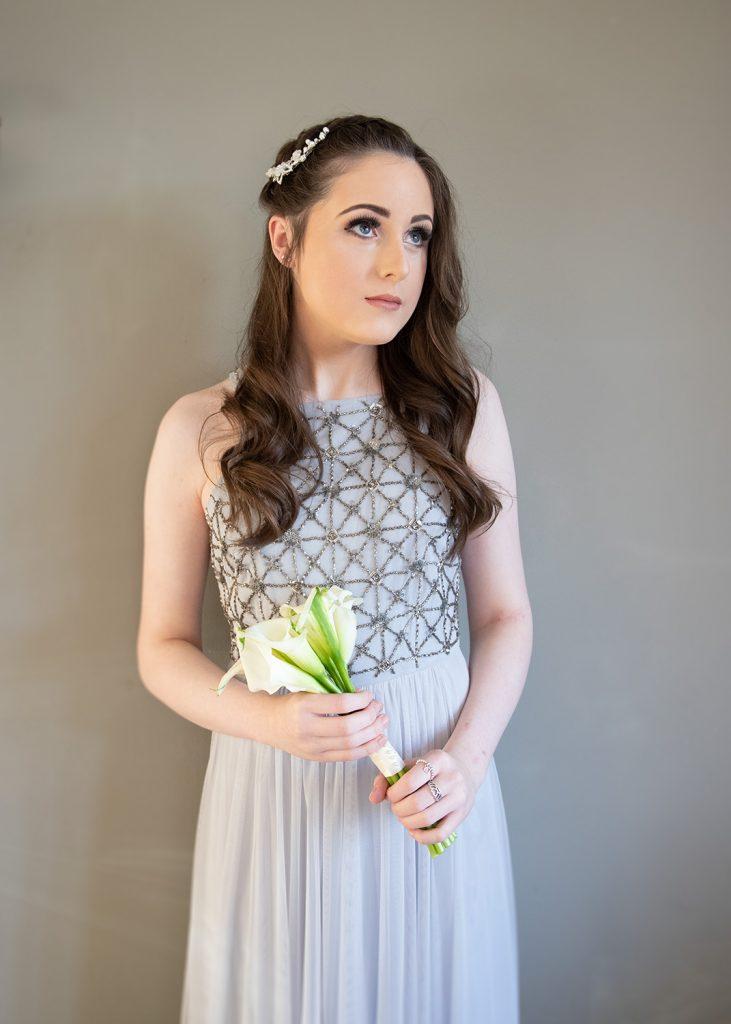 Bridesmaid posing in brides room