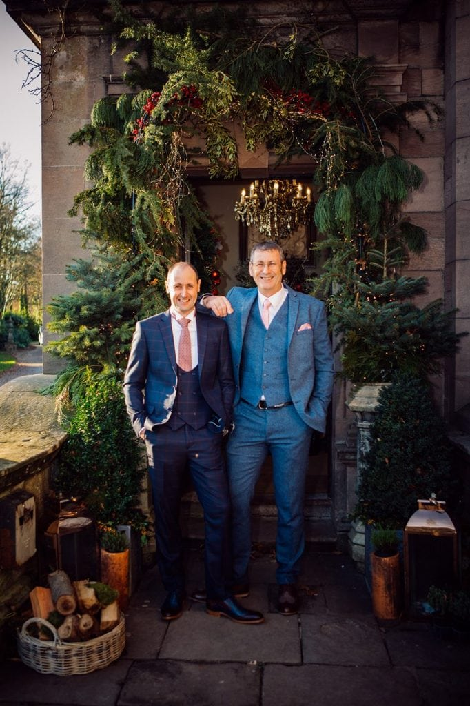 Groom with his brother outside the enterance of Ellingham Hall in Northumberland