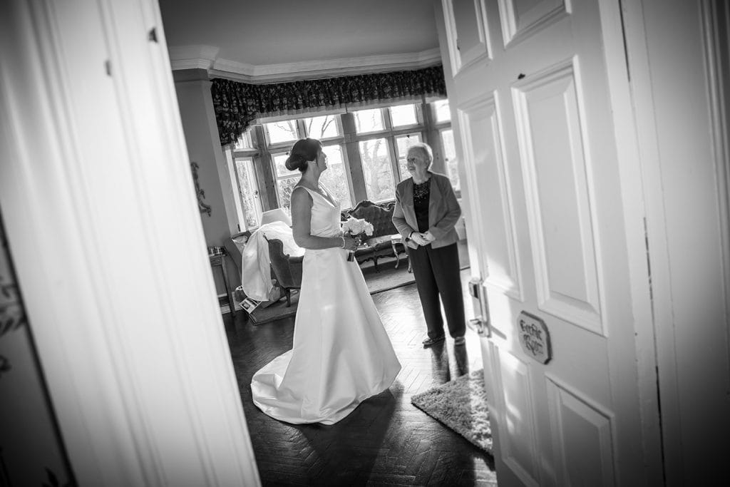 Bride talking to her mother at Ellingham Hall in Northumberland