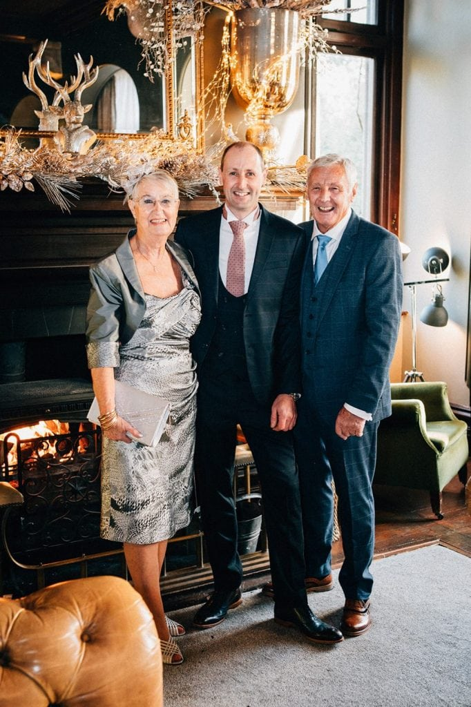 Groom with his parent at Ellingham Hall in Northumberland