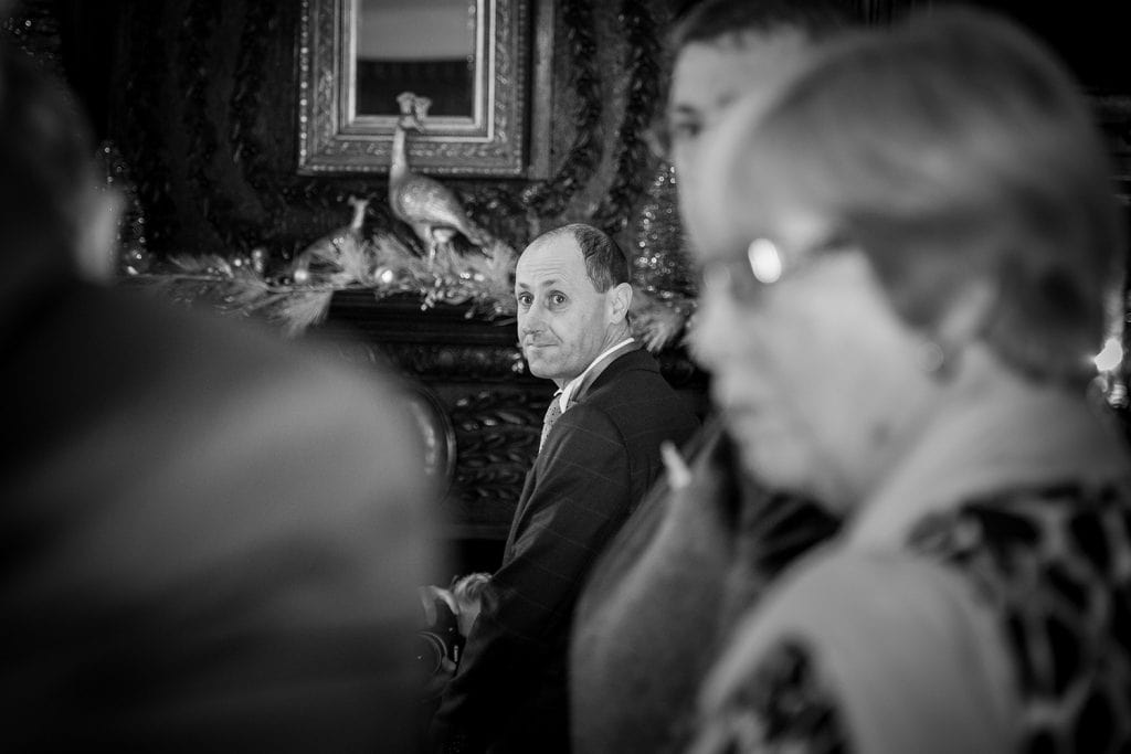 The grooms first glimse of his bride at Ellingham Hall in Northumberland