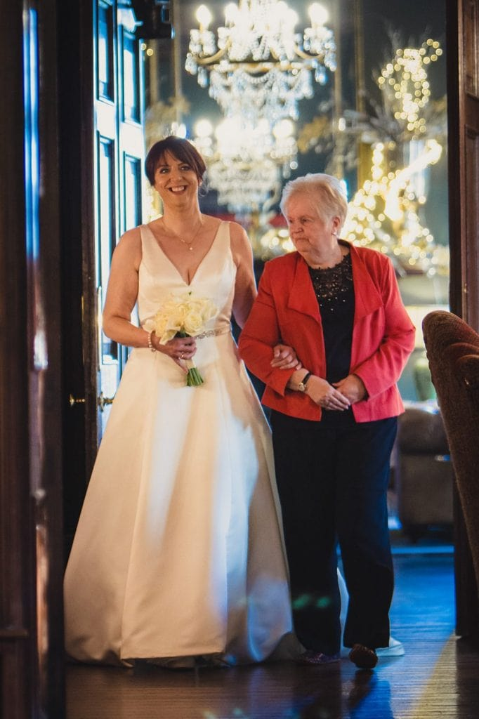 The bride being walked down the aisle by her Mother at Ellingham Hall in Northumberland