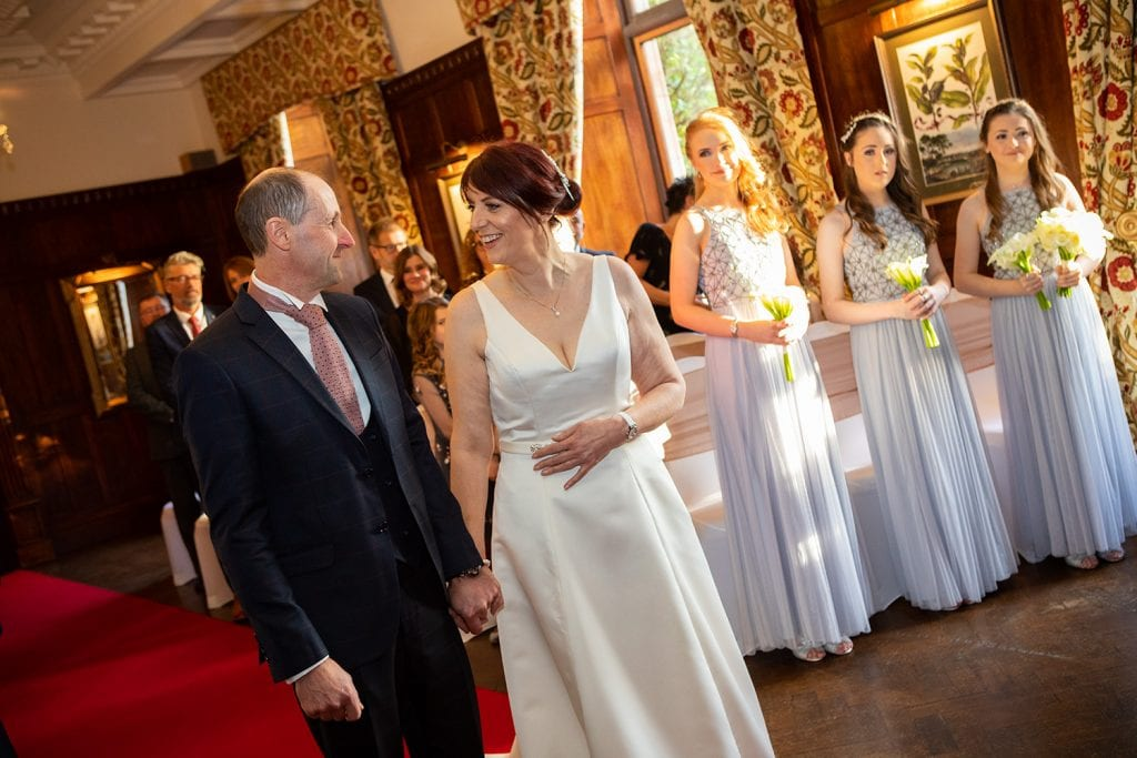 Bridesmaids watching the bride & groom at Ellingham Hall in Northumberland