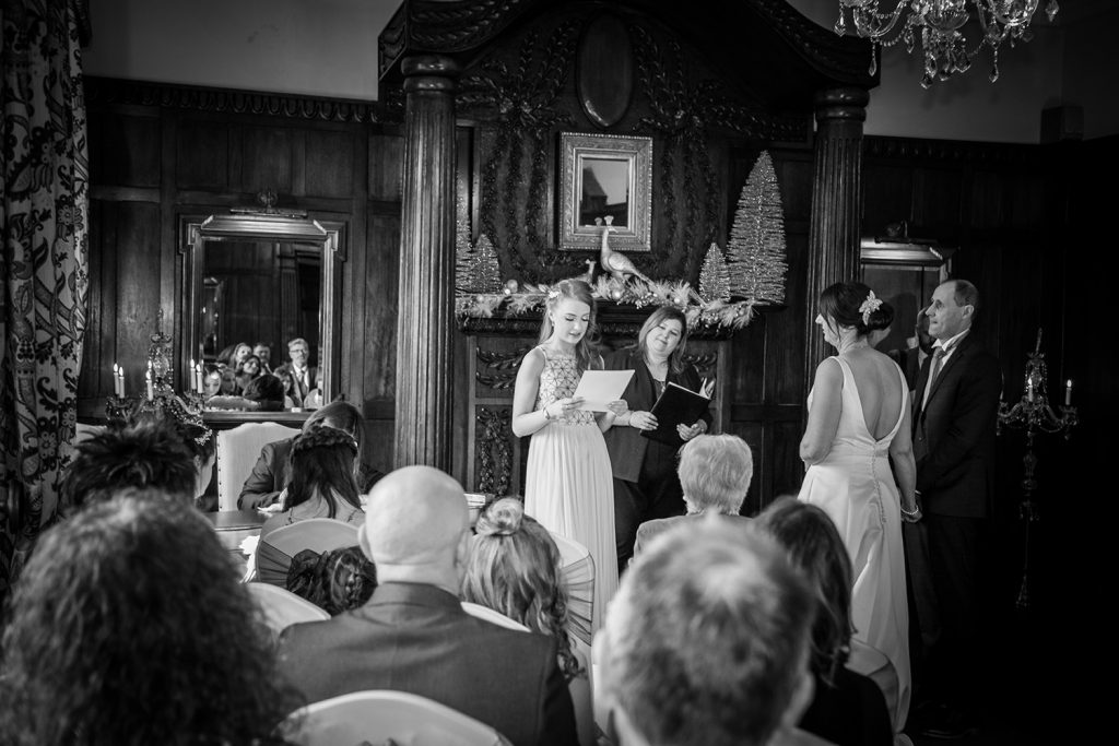 Bridesmaids giving a reading at Ellingham Hall in Northumberland