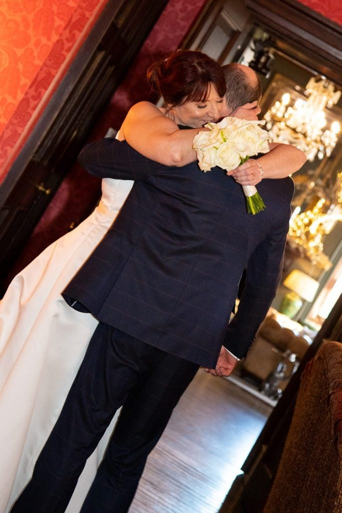 Bride and groom having a hug after the wedding sevice