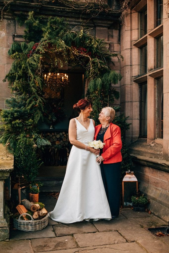 The bride & her mother in the enterance of Ellingham Hall in Northumberland