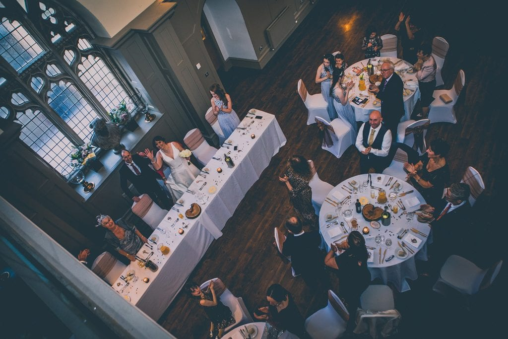 From above the Bride & Groom welcomed to the wedding breakfast at Ellingham Hall in Northumberland