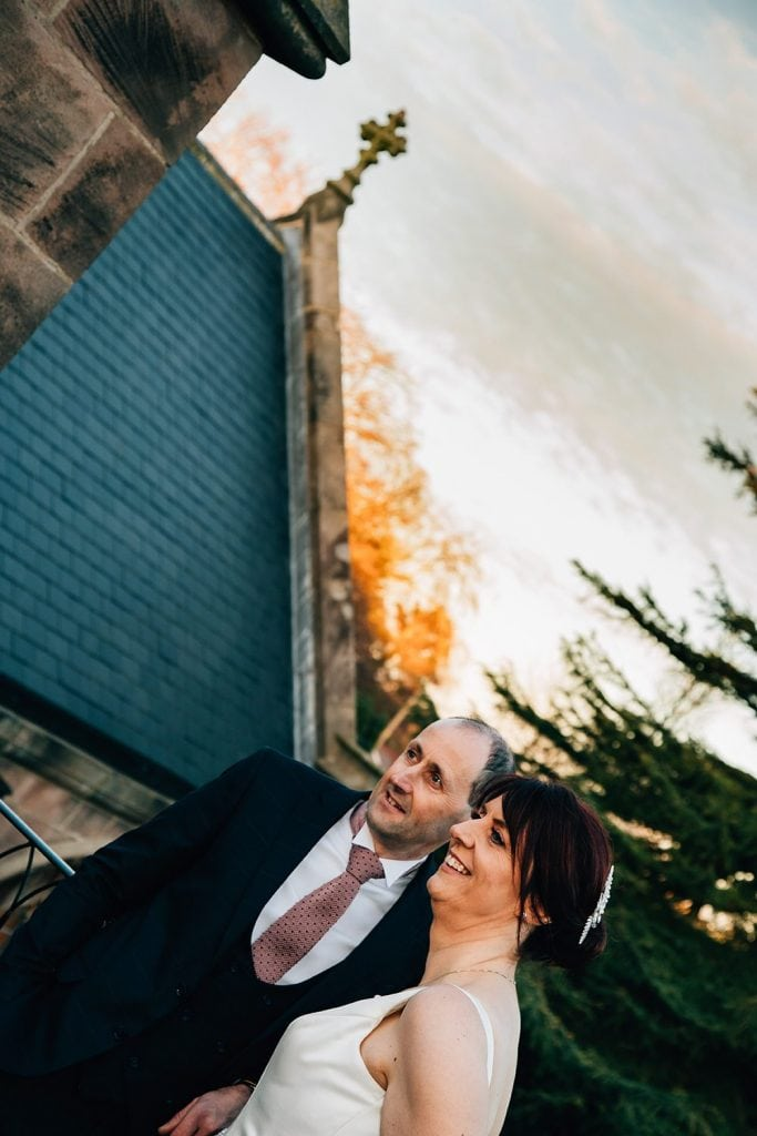 The Bride & Groom enjoying the sunset at Ellingham Hall in Northumberland